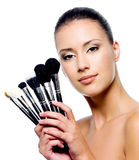 Beautiful Woman With Makeup Brushes Royalty Free Stock Photography