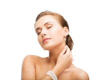 Beautiful Woman With Pearl Earrings And Bracelet Stock Images