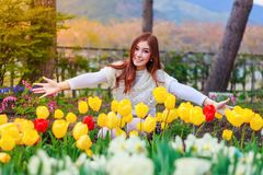 Beautiful Woman With Tulips Flowers In Garden Stock Photo