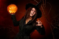 Beautiful woman witha pumpkin in the hands Stock Photo