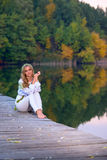 Beautiful woman on a wooden bridge Stock Photos