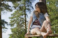Beautiful woman on wooden railing Royalty Free Stock Photo