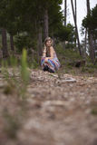 Beautiful woman in the woods Royalty Free Stock Image