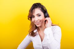 Beautiful woman working as a telemarketer wearing a headset stock photo