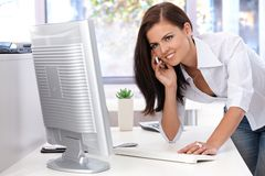 Beautiful woman working in bright office smiling Stock Photography