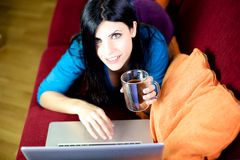 Beautiful woman working with computer at home Royalty Free Stock Images