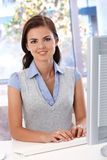Beautiful woman working at desk smiling Royalty Free Stock Photo