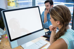 Beautiful woman working on desktop pc. Beautiful women working on desktop pc in office Stock Images