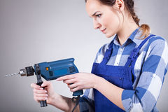 Beautiful woman working with drill Stock Image