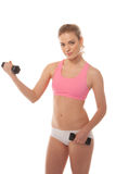 Beautiful woman working with dumbbells Stock Image