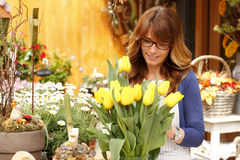 Beautiful woman working in flower shop Stock Image