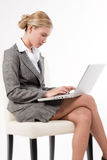 Beautiful woman working on her laptop. Beautiful business woman working on her laptop, isolated on white Stock Images