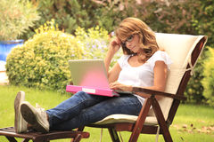 Beautiful woman working at home Stock Photography