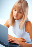 Beautiful woman working with laptop Royalty Free Stock Image