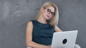 Beautiful woman working on laptop at office stock footage