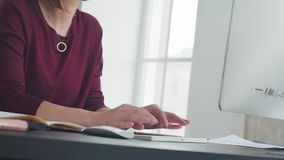 Beautiful woman is working in office, quickly typing on the keyboard. Beautiful woman is working in the office and quickly typing on the computer keyboard. Text stock video