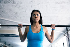 Beautiful woman working out with barbell Stock Image