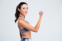 Beautiful woman working out with dumbbells Royalty Free Stock Photography