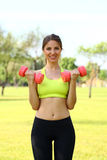 Beautiful woman working out with dumbbells Stock Image