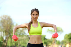 Beautiful woman working out with dumbbells Stock Photos