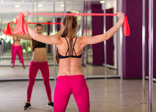 Beautiful woman working out at the fitness studio. Beautiful  active woman working out at the fitness studio Royalty Free Stock Photo