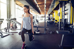 Beautiful woman working out in gym Royalty Free Stock Photos