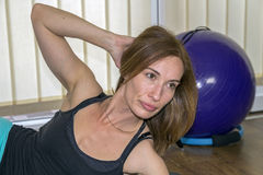 Beautiful Woman Working Out in a Gym Royalty Free Stock Photography