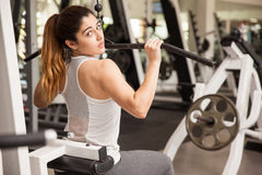 Beautiful woman working out at the gym stock photo