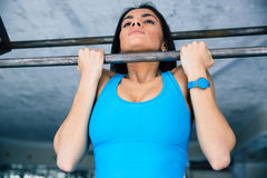 Beautiful woman working out on horizontal bar Royalty Free Stock Photo