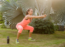 Beautiful woman working out in summer park Royalty Free Stock Photos