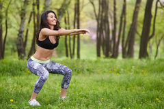 Beautiful woman working out in summer park Stock Photo