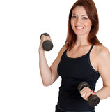 Beautiful woman working out with weights. A beautiful woman working out with weights stock images
