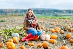 Beautiful woman working on pumpkin field Royalty Free Stock Photos