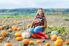 Beautiful woman working on pumpkin field Stock Images