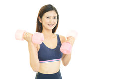 Beautiful woman works out Stock Photo