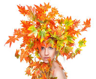 Beautiful woman wrapped in autumn leafs Royalty Free Stock Photos