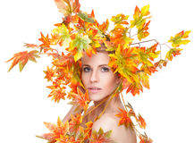 Beautiful woman wrapped in autumn leafs Royalty Free Stock Images