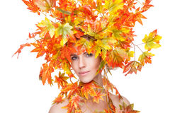 Beautiful woman wrapped in autumn leafs Stock Photo