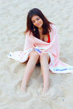 Beautiful woman wrapped herself with blanket on the beach Stock Image