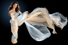 Beautiful woman wrapped in silk fabric Stock Photo