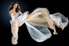 Beautiful woman wrapped in silk fabric stock photo