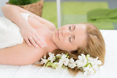 Beautiful woman wrapped in a towel laying in spa Stock Photo