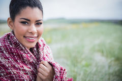 Beautiful woman wrapped up in warm clothing Stock Images