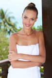 Beautiful woman wrapped in white towel Royalty Free Stock Photography