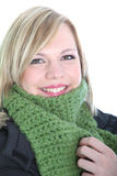 Beautiful woman wrapped in a winter scarf Stock Photos