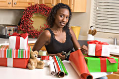 Beautiful woman wraps presents Stock Photo