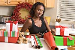 Beautiful woman wraps presents stock photo