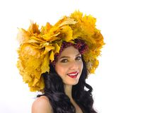 Beautiful woman in wreath of autumn leaves and guelder-rose on w Stock Photos
