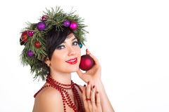 A beautiful woman in a wreath of Christmas tree branches and New Royalty Free Stock Photography