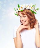 Beautiful woman in a wreath of flowers Royalty Free Stock Images
